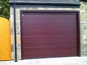 red wood finish garage door